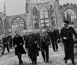British Prime Minister Winston Churchill inspecting the ruins of Coventry Cathedral following a November 1940 German air raid. Photo courtesy of the Library of Congress.