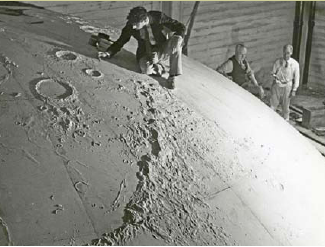 Artist working on the moon sculpture for the Griffith Park Observatory in Los Angeles. Photograph by R. M. Starrett. From the John C. Austin Papers (Collection Number 904). Courtesy of the Department of Special Collections, Charles E. Young Research Library, UCLA.